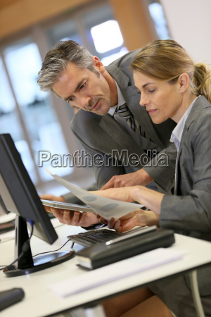 business people working in office on