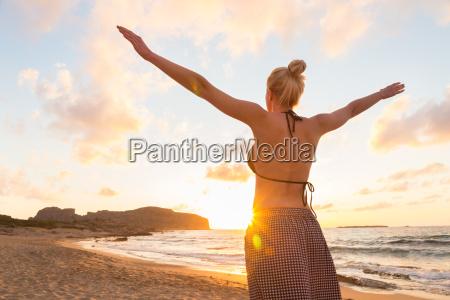 free happy woman enjoying sunset on