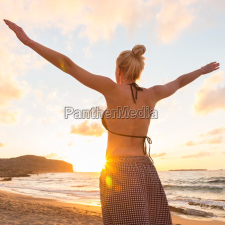 free happy woman enjoying sunset on