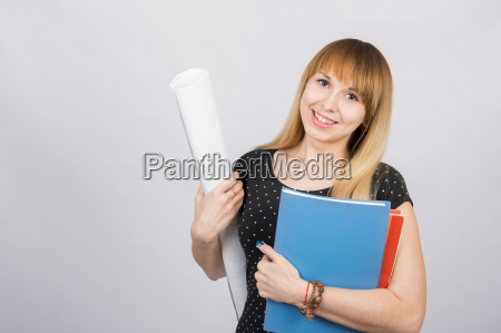 girl student smiling and holding blueprints