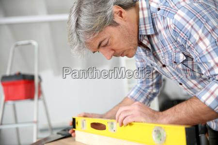 closeup of craftsman using level