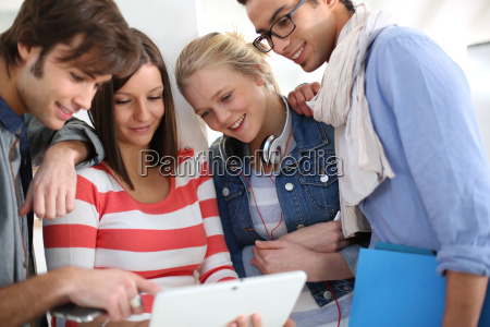 young people in college websurfing on