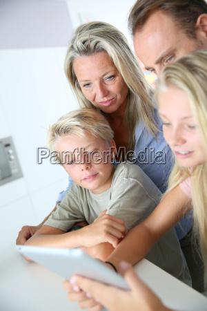 kids using digital tablet at home