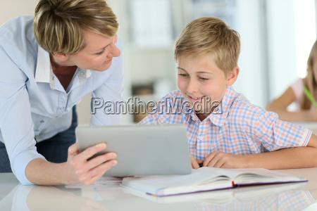 teacher using digital tablet as educational