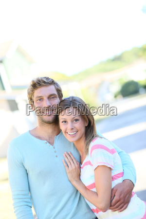 portrait of cheerful couple standing in