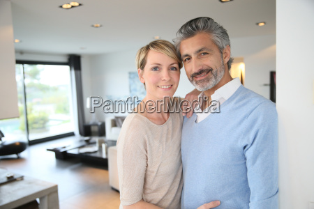 smiling middle aged couple standing in