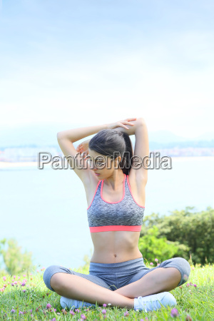 young fitness woman doing stretching exercises