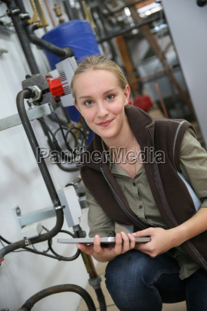 young woman controlling water level in