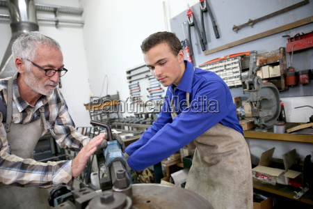 young man in ironworks training with