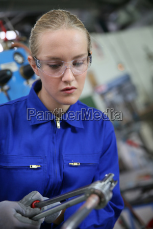 young woman studying ironworks in professional