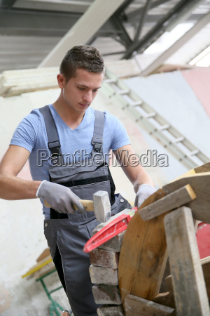 young man in masonry professional school