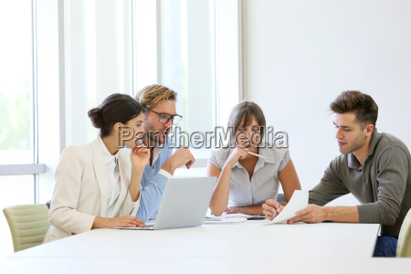 business people meeting around table in