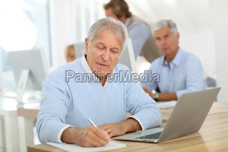portrait of senior man working on