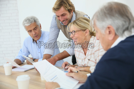 business instructor with group of senior