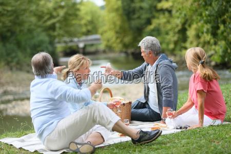 group of senior people enjoying picnic
