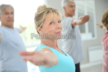 senior people stretching out in fitness