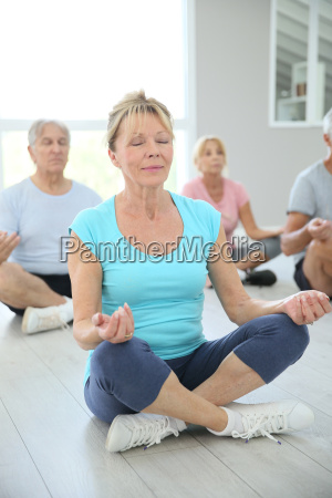 group of senior people doing yoga