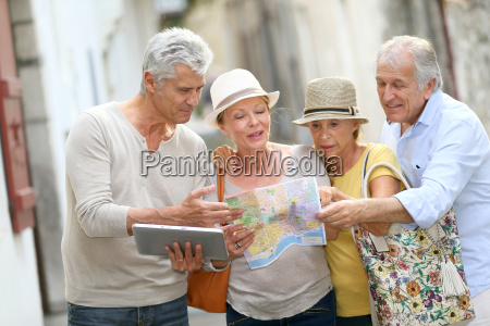 group of senior people traveling in
