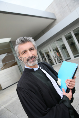 portrait of lawyer standing outside courthouse