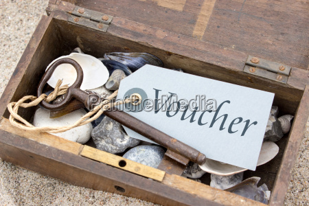 voucher in a wooden box with
