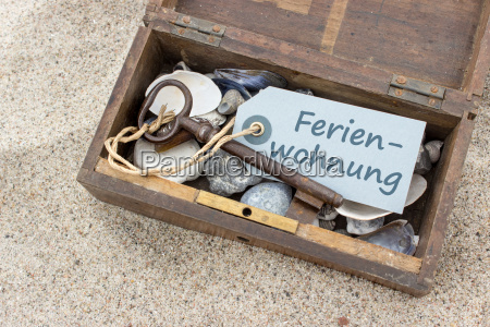 wooden box with shells stones keys
