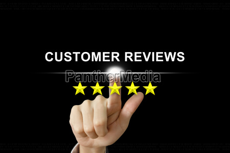 business hand pushing customer reviews on