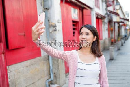 woman taking selfie in macau city