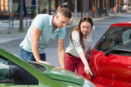 woman showing man car collision