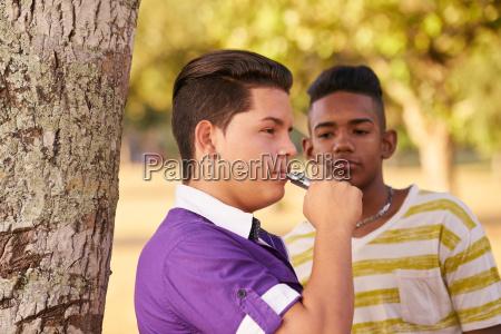 group of teens smokers boy smoking