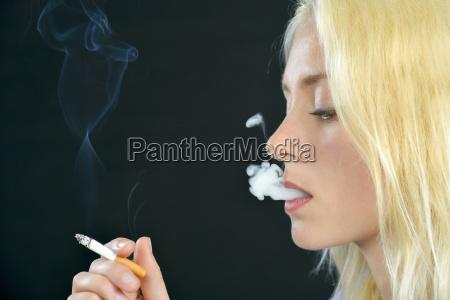 blond woman smoking