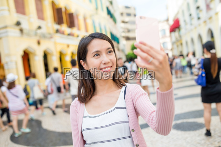 woman use of mobile phone taking