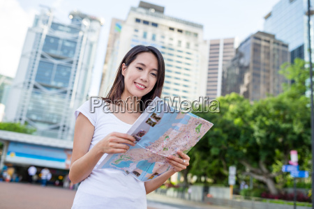 woman looking for location on city