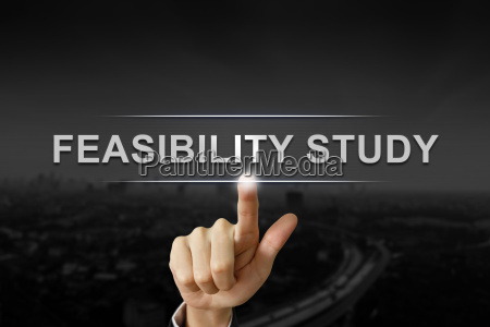 business hand pushing feasibility study button