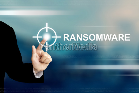 business hand clicking ransomware button on