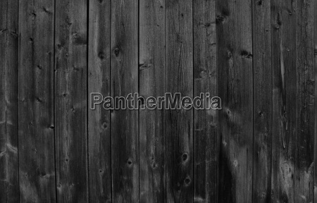 dark wooden wall as background wood