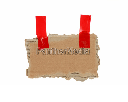 old isolated cardboard with red tape