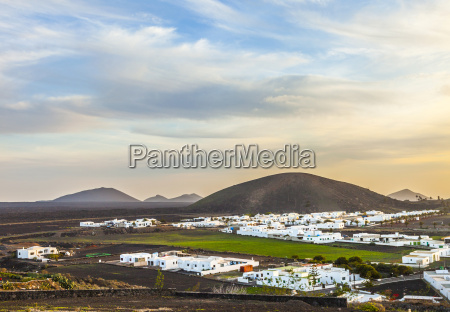 sunset over village of yaiza in