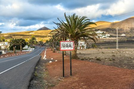 street sign of village of uga