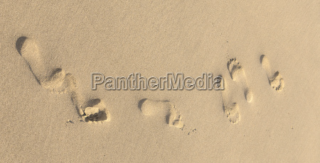 footprints on yellow sand