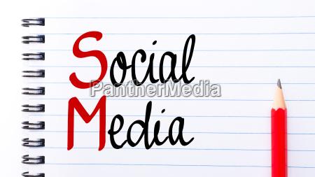 sm social media written on notebook