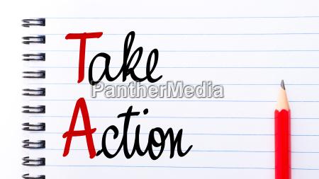 ta take action written on notebook