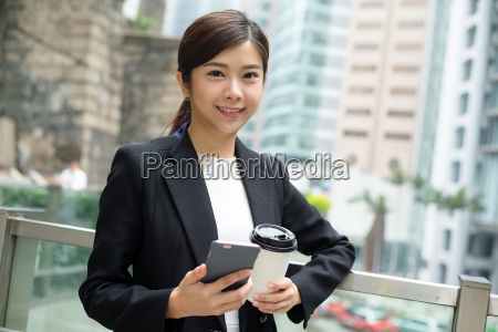 asian business woman use of cellphone
