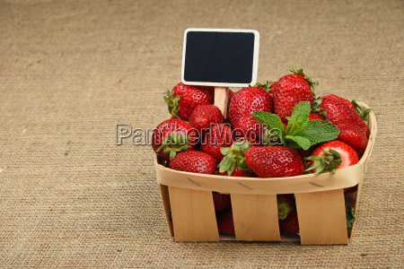 strawberry in basket with price sign