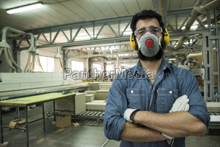 man with hearing protection mask safety