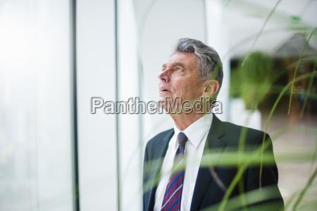 senior businessman looking up at a