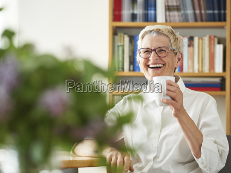 portrait of laughing senior woman with