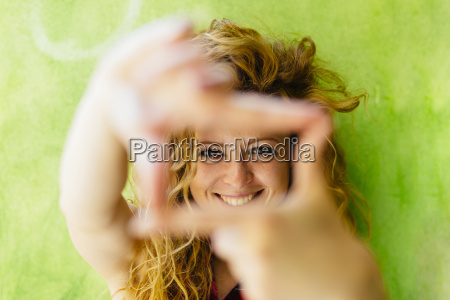 portrait of smiling woman shaping a