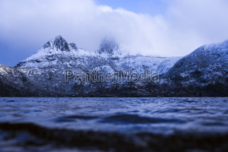 cradle mountain covered by winter snowfall