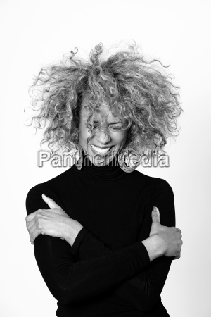 portrait of laughing woman with afro