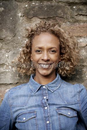 portrait of smiling woman wearing denim